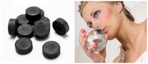 Таблетки активированного угля и девушка пьёт воду